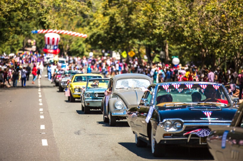Cars with flags in the foreground, Uncle Sam hat in background at Thomas Hawk 50th Annual Piedmont 4th of July Parade, Piedmont, California | CC-BY-NC Thomas Hawk