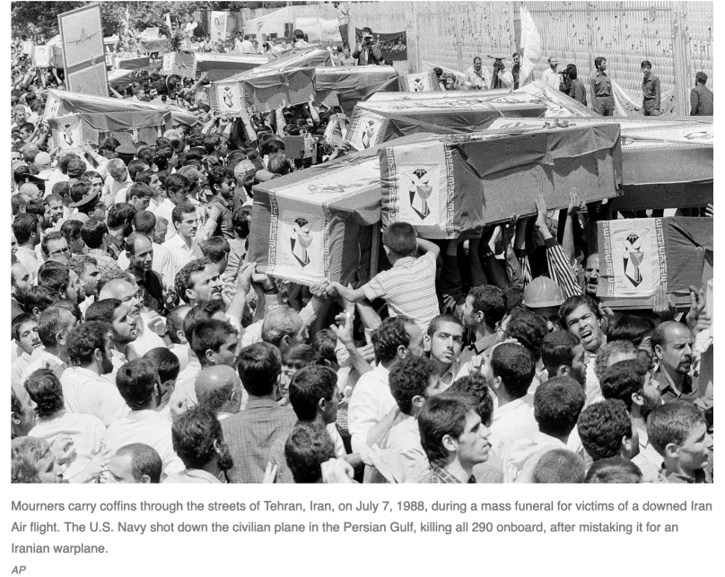 Mourners carry coffins through the streets of Tehran, Iran, on July 7, 1988, during a mass funeral for victims of a downed Iran Air flight. The U.S. Navy shot down the civilian plane in the Persian Gulf, killing all 290 onboard, after mistaking it for an Iranian warplane. (AP Photo)