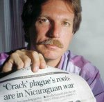 Gary Webb showing his article on the drug fall out of supplying the Nicaraguan Contras.
