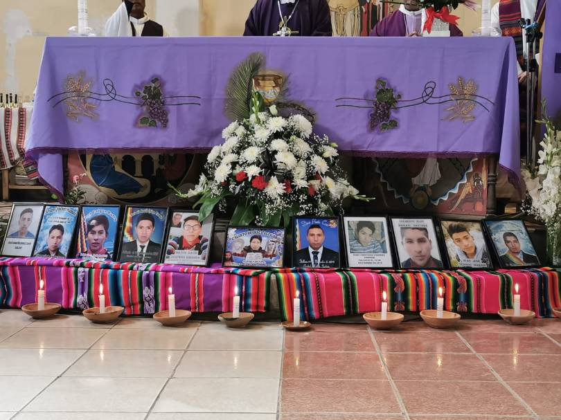 Photos of Senkata massacre victims laid out before a mass table on March 5, 2020